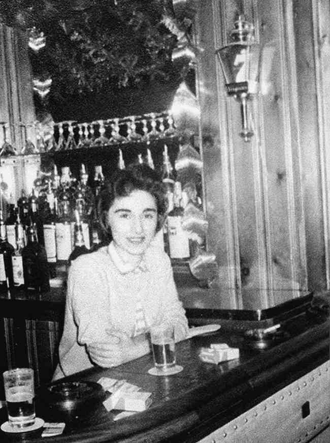 Kitty genovese tending bar