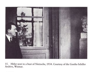 Hitler-next-to-a-bust-of-nietzsche