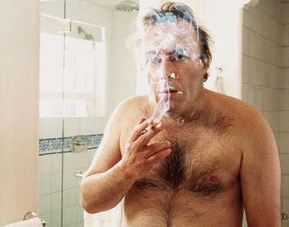Hitchens shirtless smoking